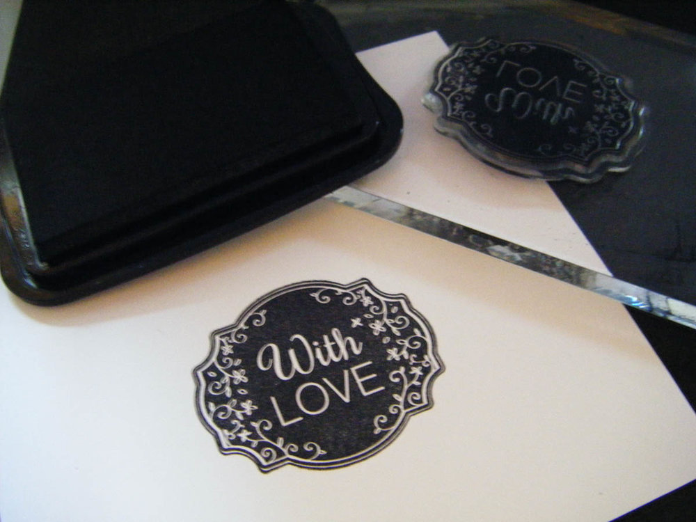 Ink-stamped design on white card stock