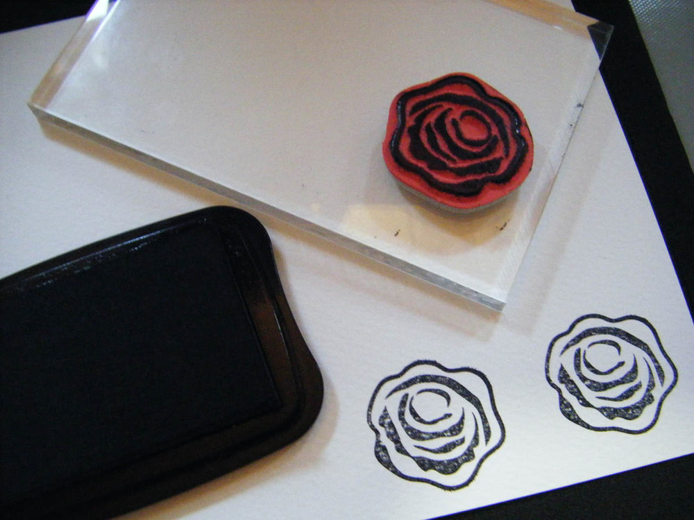 Rose ink-stamp design on white card stock