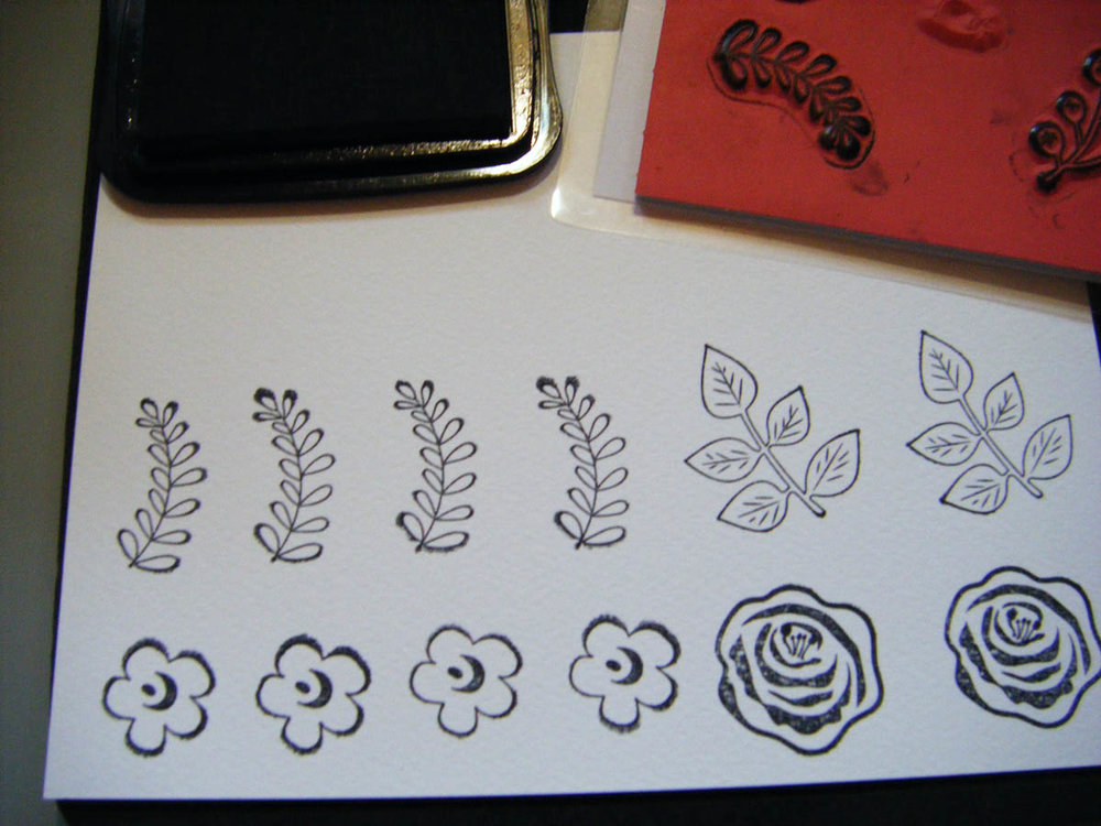 Ink-stamped floral designs on white card stock
