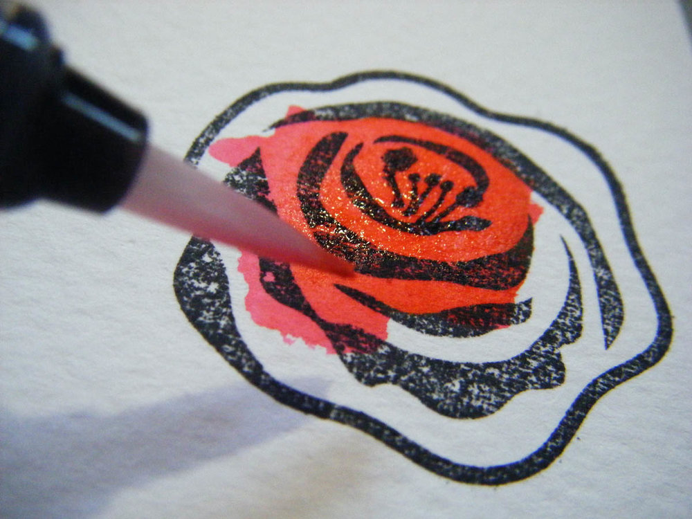 Add color to stamped rose design