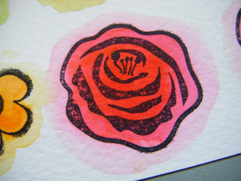 Use a water brush to extend the color outside the edges of each stamped design
