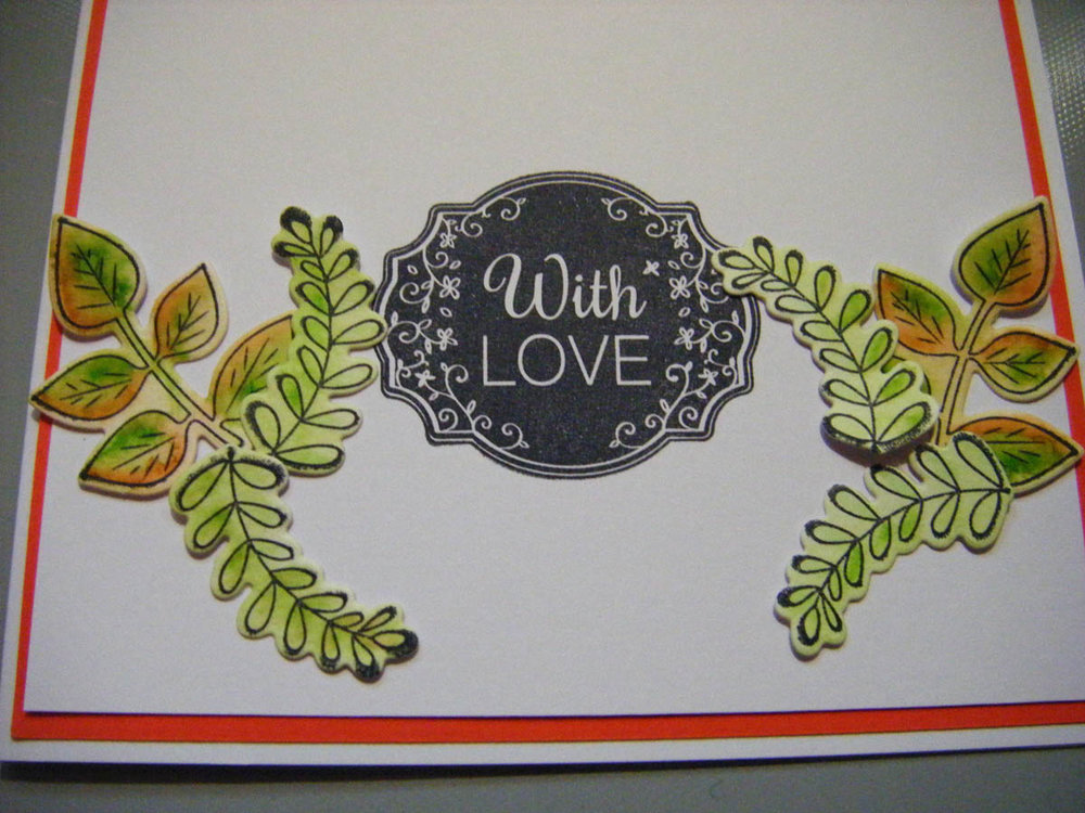 Continue glueing colored die-cut greenery shapes around the stamped sentiment