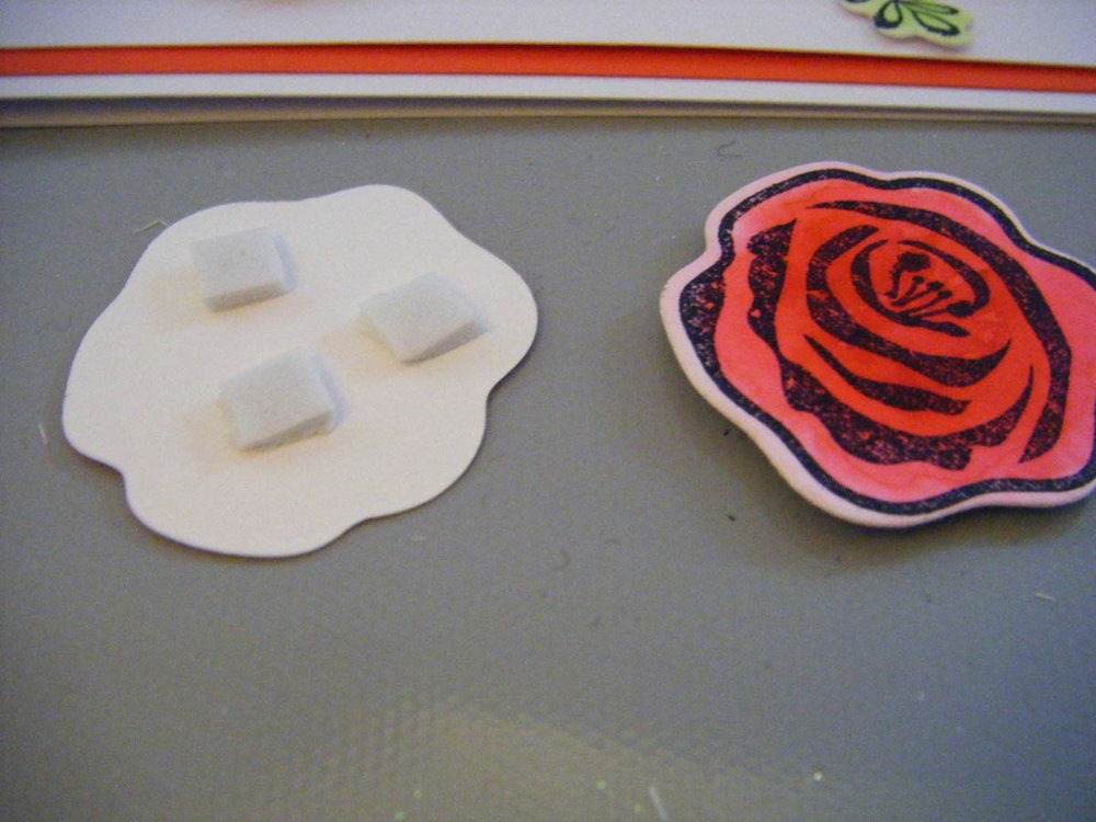 Apply 3D foam to back of die-cut flower shape