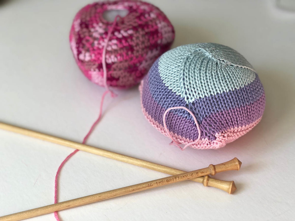 Knitted Knockers in pin and pastel yarns