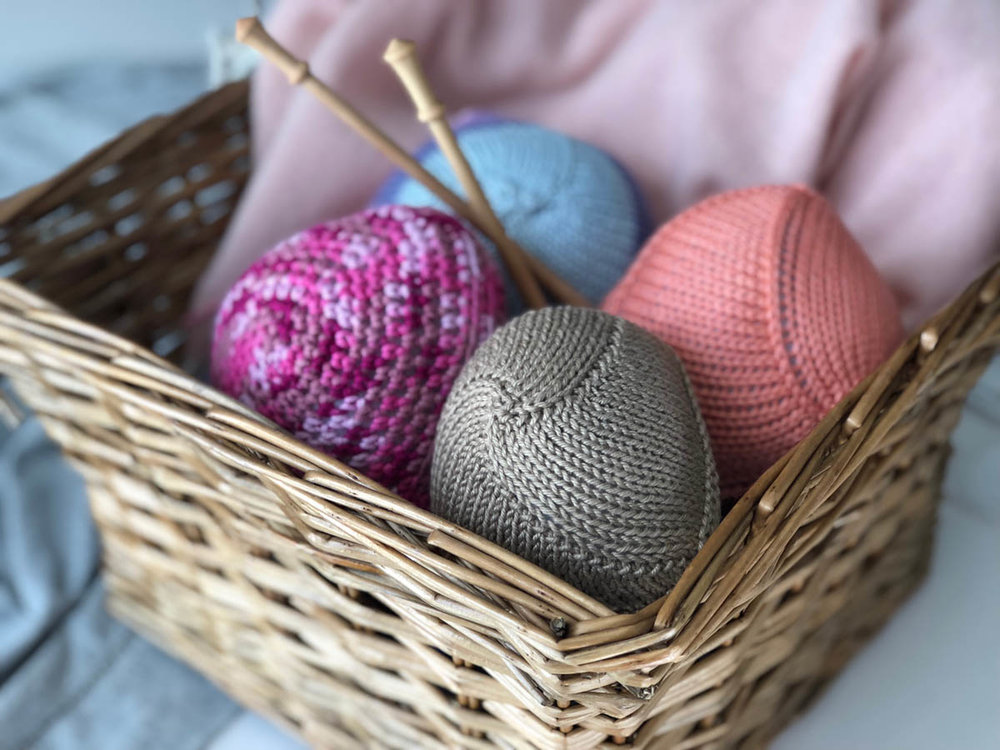 Knitted Knockers in basket, ready to be gifted