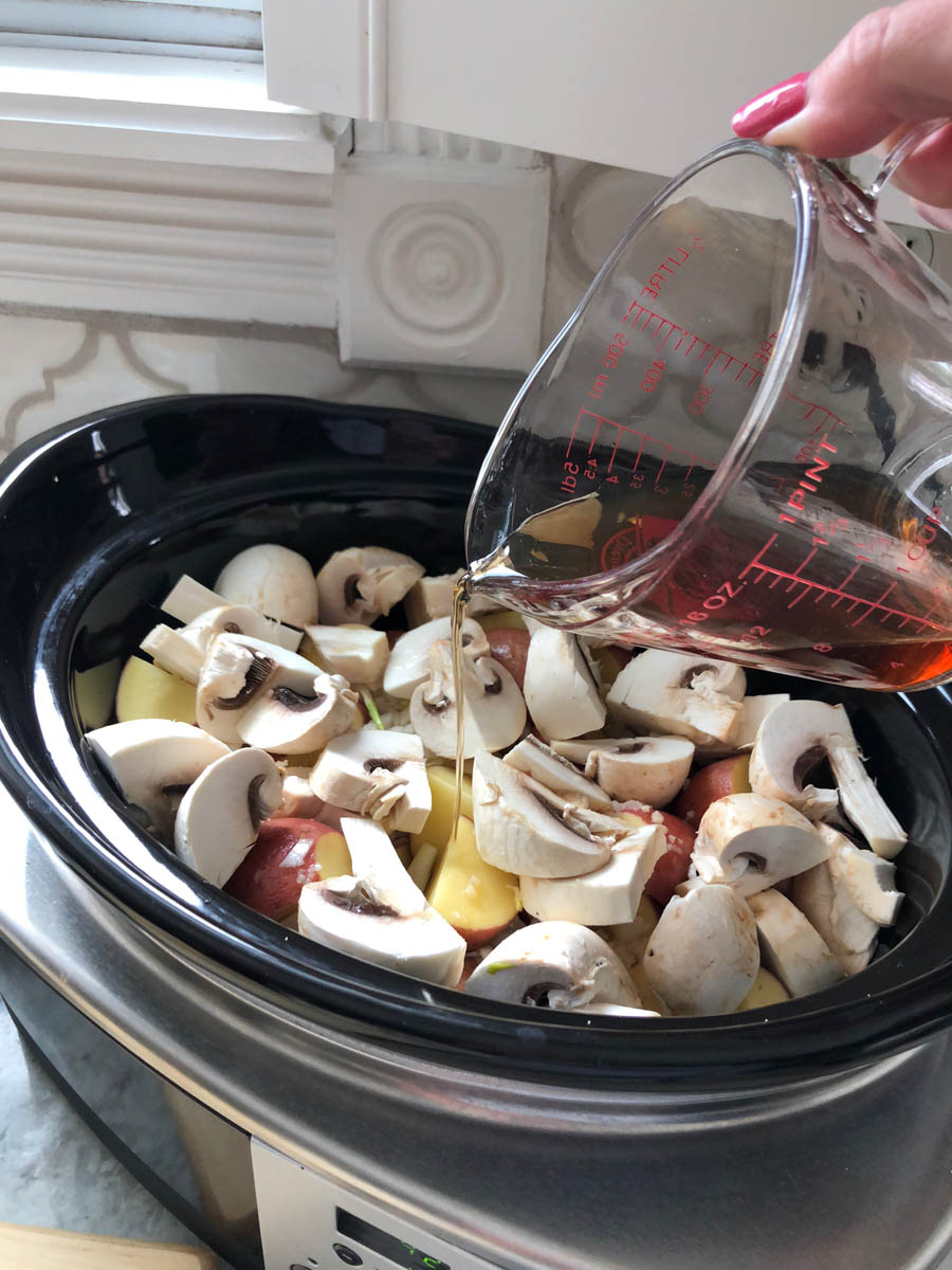 4b-pouring-broth-on-mushrooms-in-crockpot.jpg