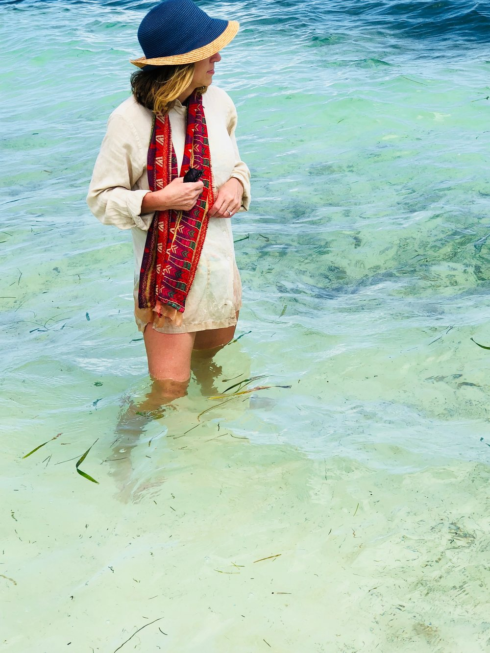 ashley modeling red geometric one-hour silk tube scarf at the beach