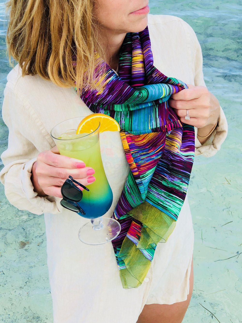 ashley modeling green striped one-hour silk tube scarf at the beach
