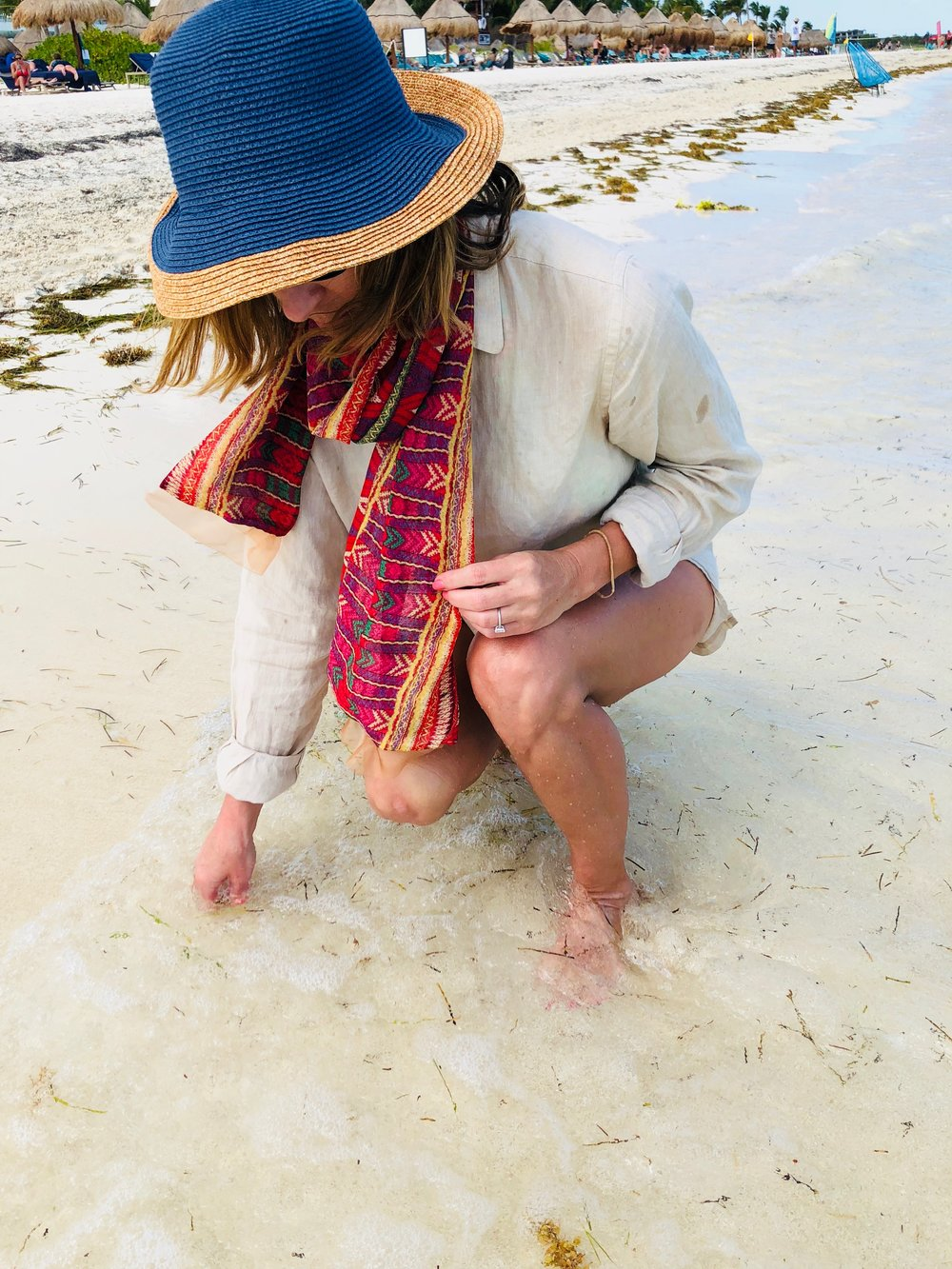 ashley modeling red geometric silk one-hour silk tube scarf at the beach