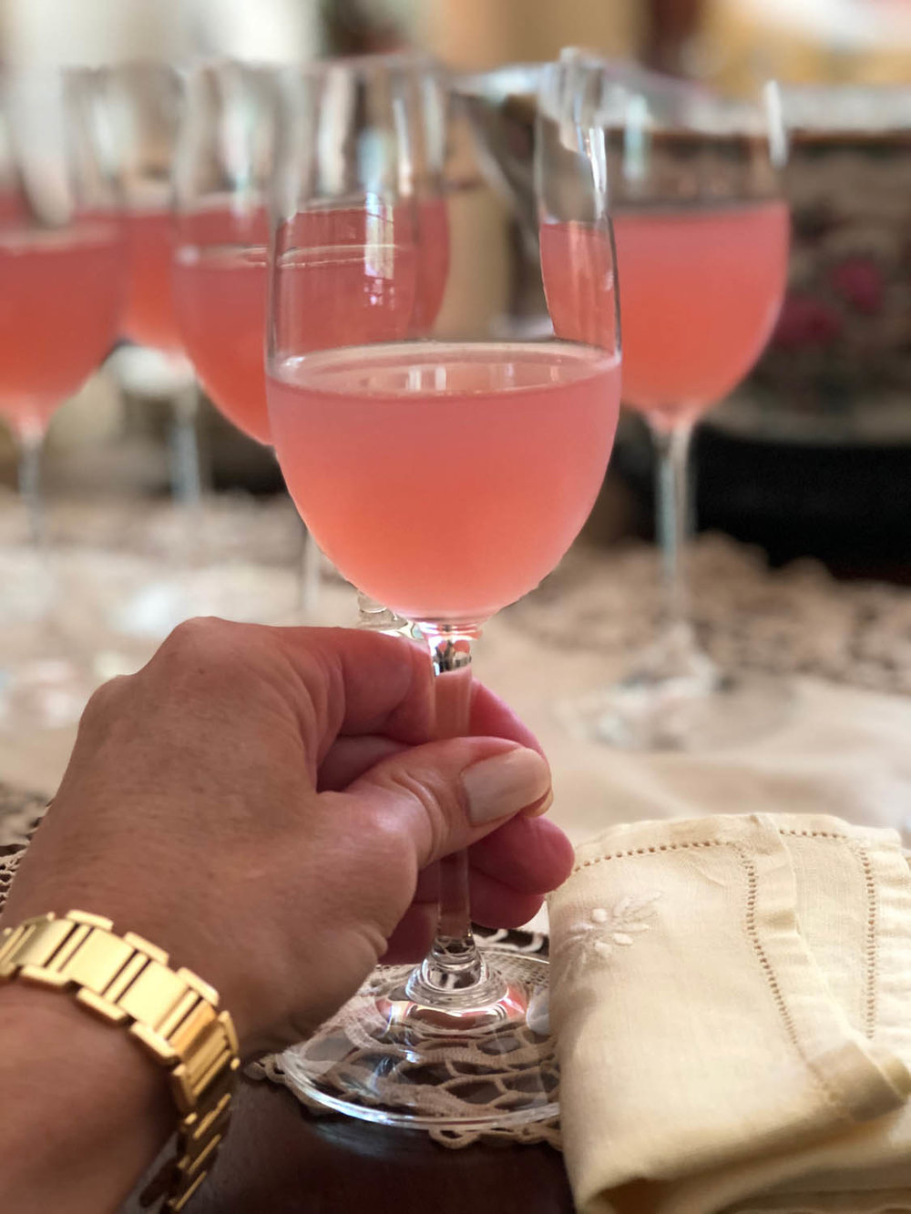 Pink lemonade in wine glasses