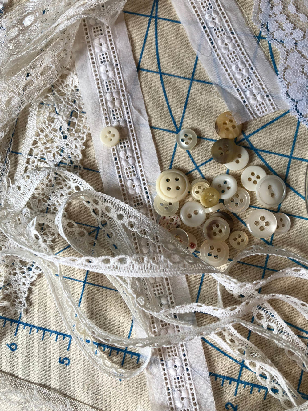 lace remnants and antique buttons