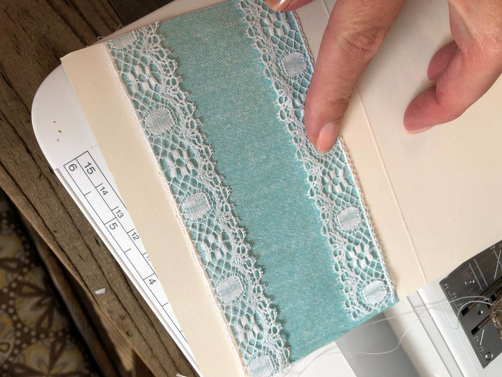 sew detail-of-sewn-lace-with-scrap-paper-on-card.jpg