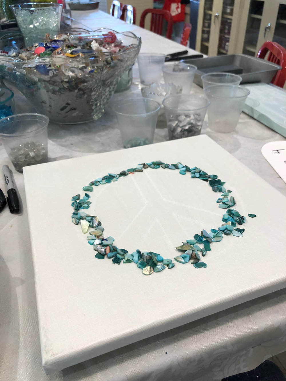 Beginning of peace sign glass artwork at The Shard Shop class