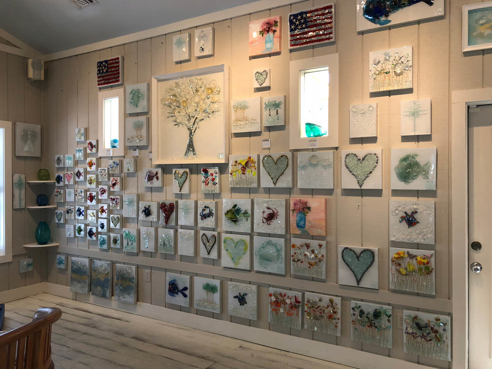 Various art on the wall at Mary Hong's studio in Grayton Beach, Florida