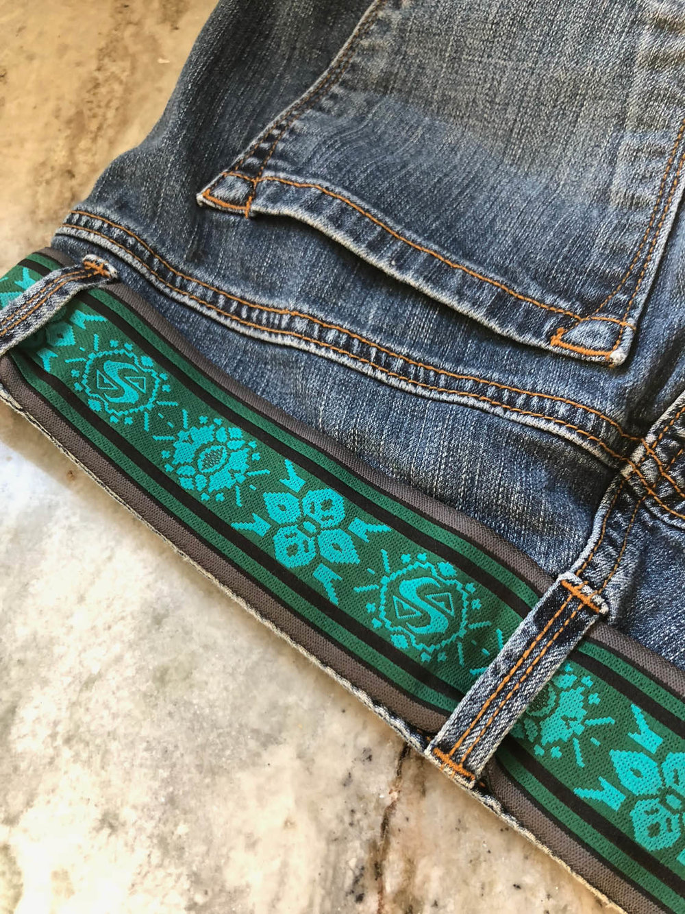 upholstery trim for belt on embellished denim blue jeans