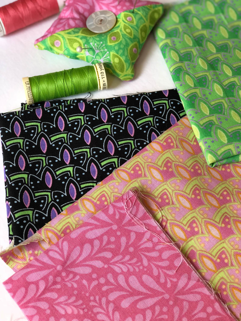 scraps of fabric and quilting thread
