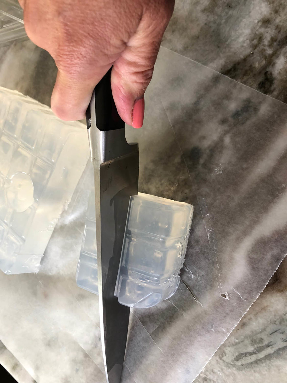 cutting up cubes of glycerine soap