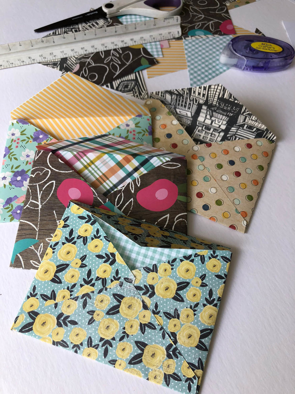 Supplies for making DIY envelopes with scrapbook paper