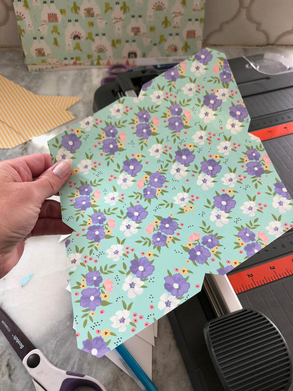 trimming front paper for DIY envelopes with scrapbook paper
