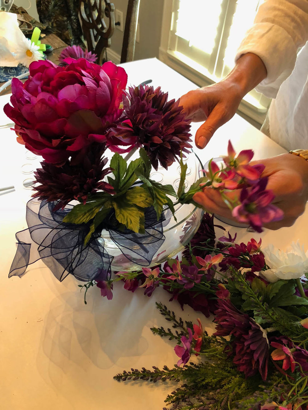 adding silk flowers to Bow K base for simple centerpiece arrangements