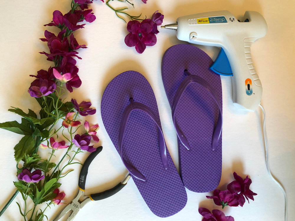 Silk flower stems, wire cutters, glue gun and flip flops to embellish flip flops with silk flowers