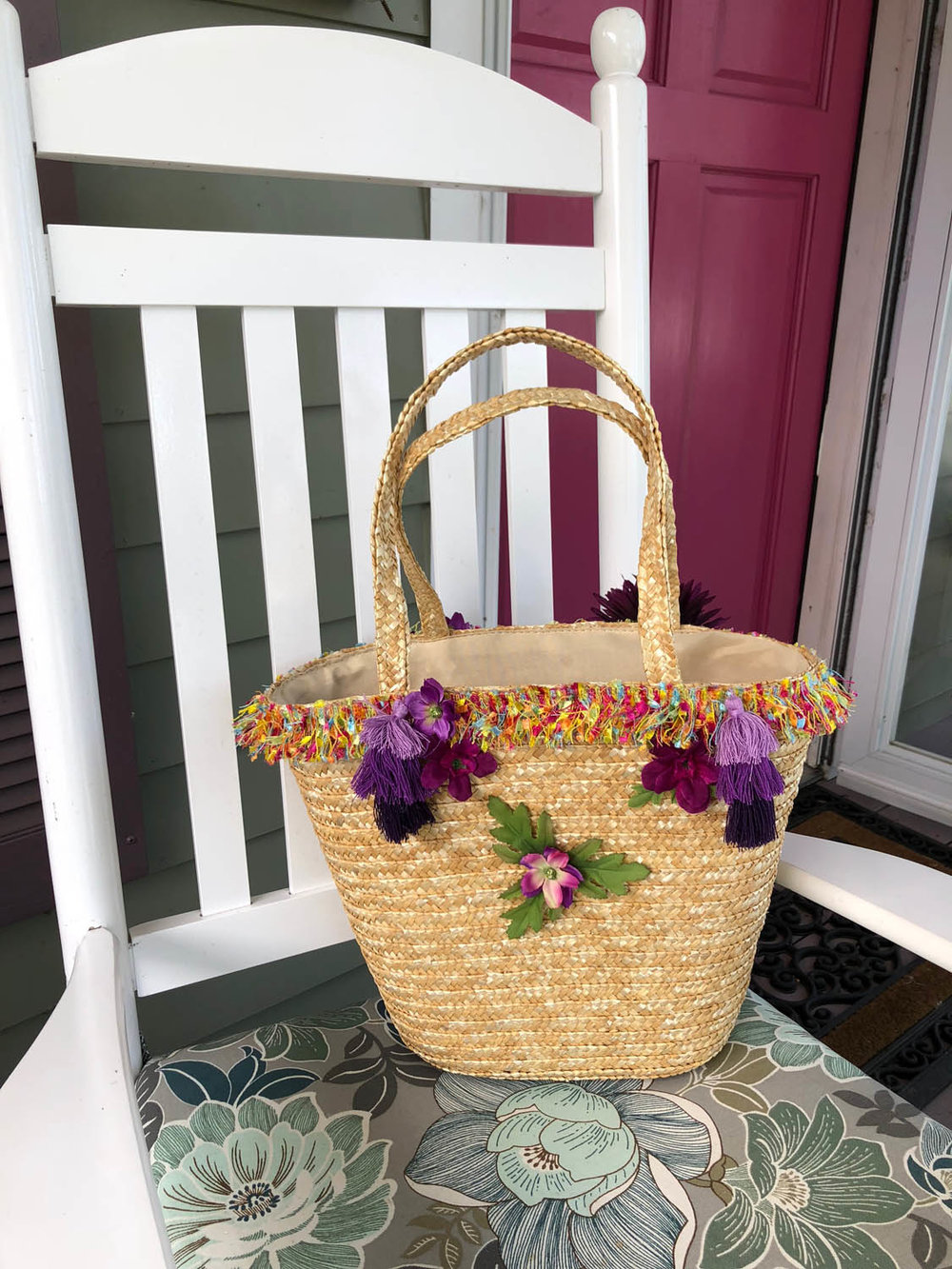 embellished straw tote on a white porch rocker