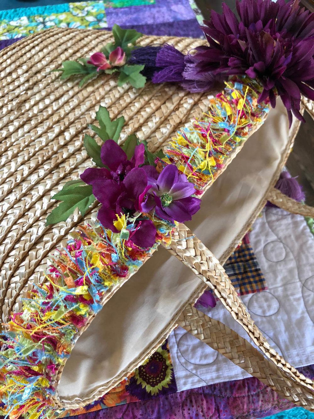 summer embellished straw tote bag on a quilt