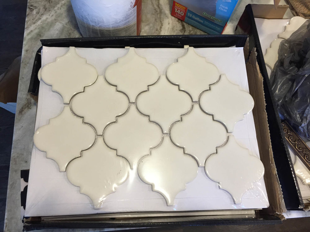 Off-white ogee tile for kitchen counter backsplash.