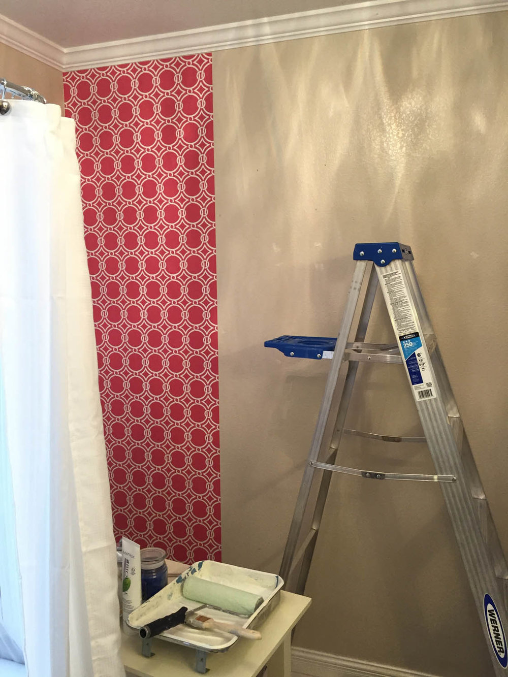 First strip of wallpaper in master bathroom at Curtice Cottage.