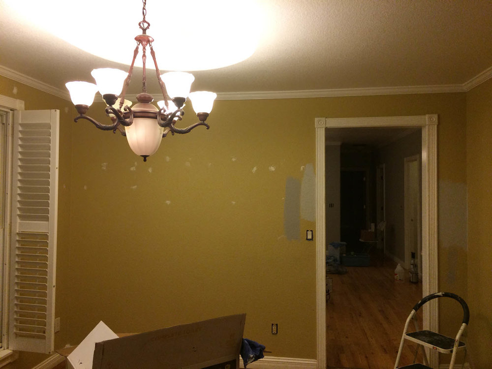 Dining room before light fixture and paint renovation