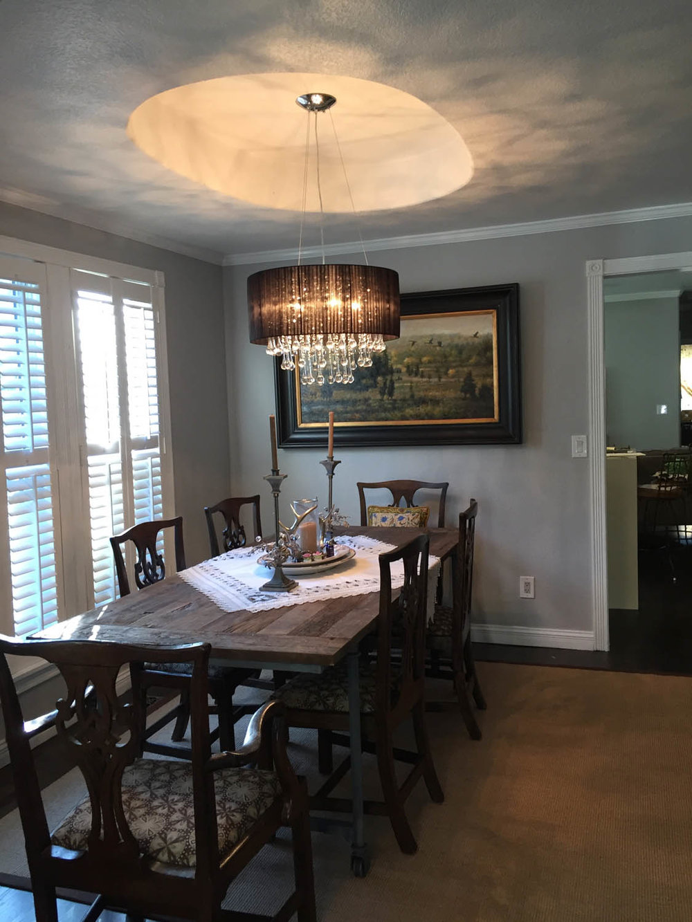 Finished dining room of Curtice Cottage with new colors and light fixture
