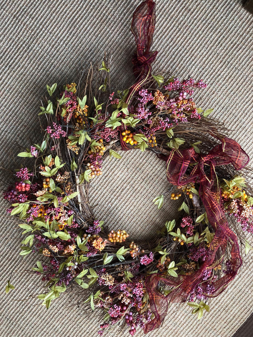 red berry version of hand made fall wreath