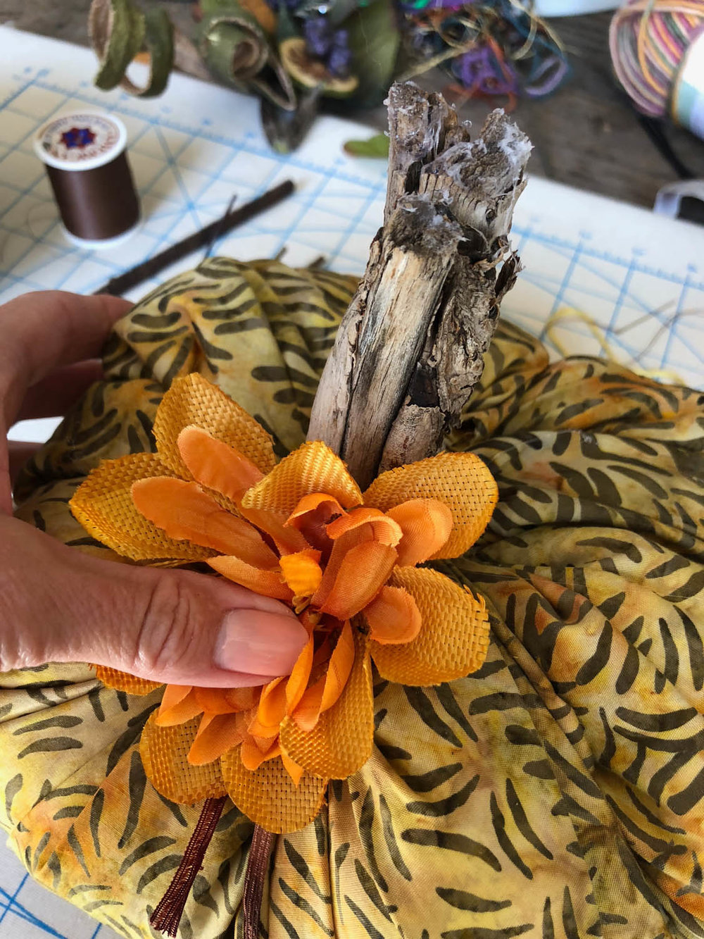 adding fall floral embellishments to fast fun fabric pumpkin