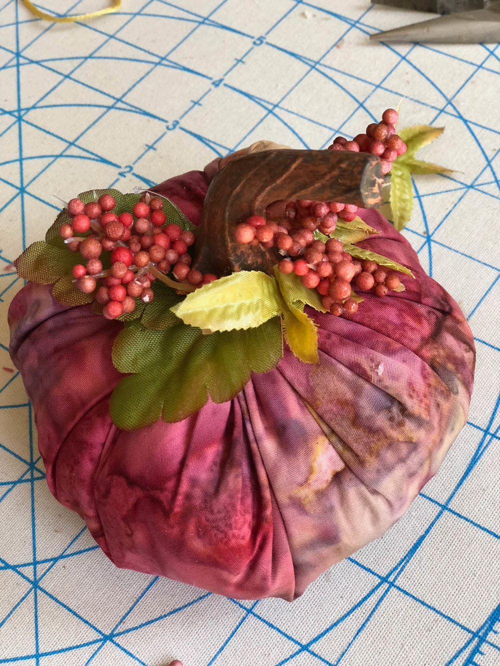 berries and leaves embellishment on fast fabric pumpkin