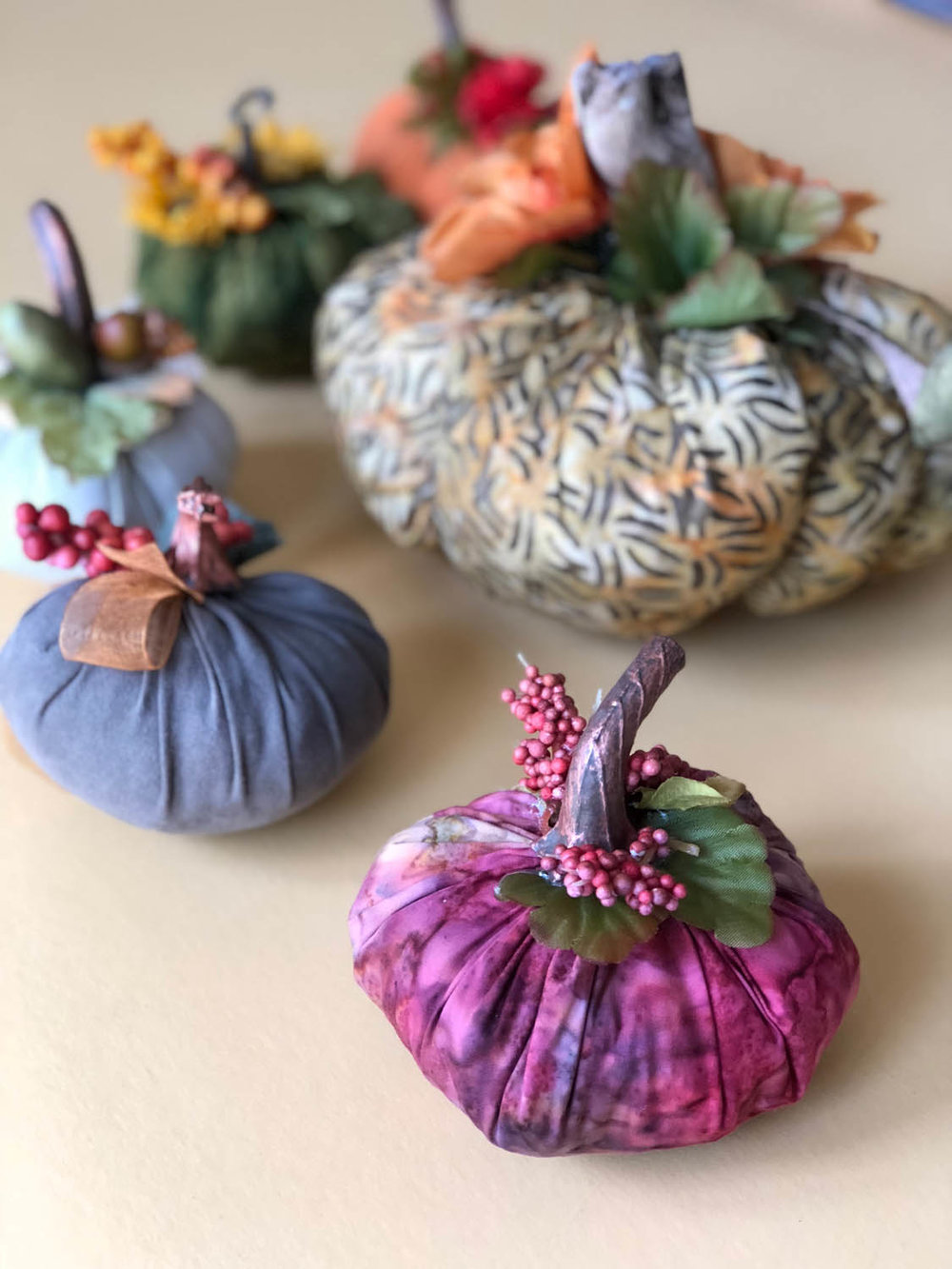 group of fast fabric pumpkins with embellishments