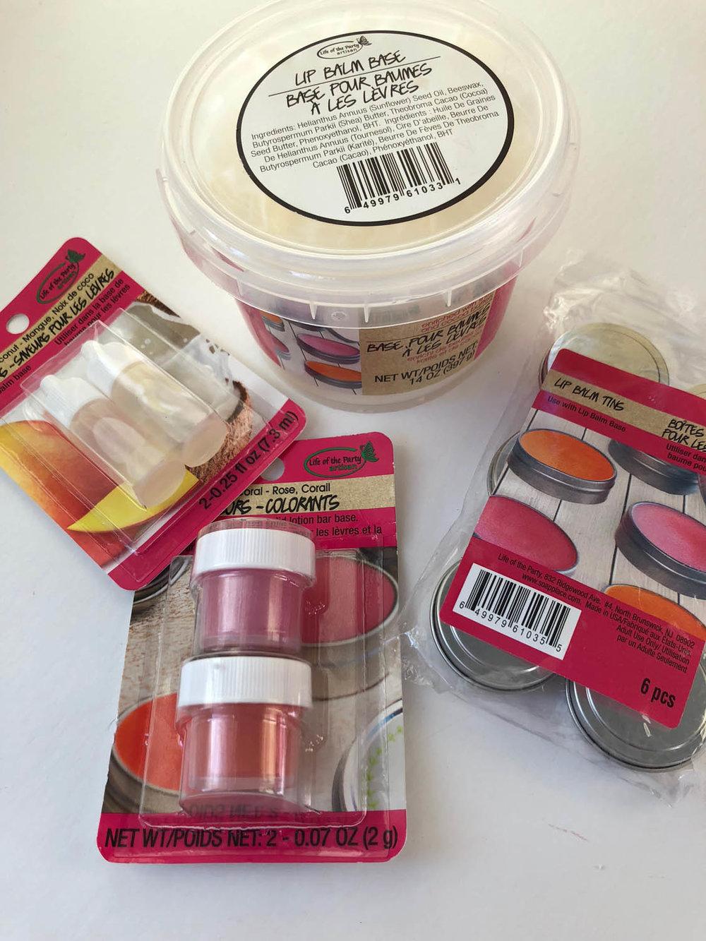 Easy homemade lip balm supplies: metal tins, lip balm base, lip balm colorant, lip balm fragrance/flavoring.