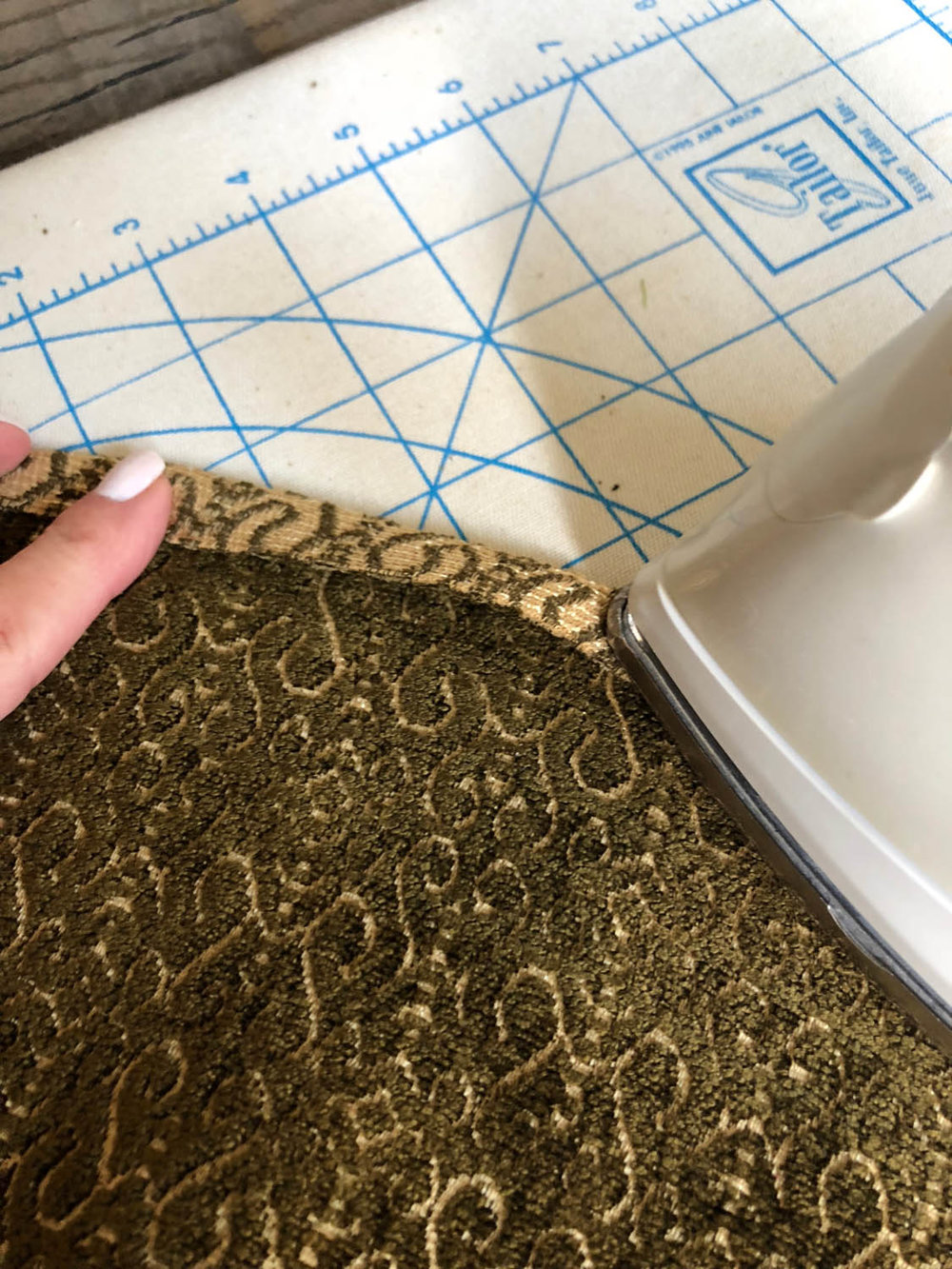 pressing under the raw edges of upholstery fabric circle