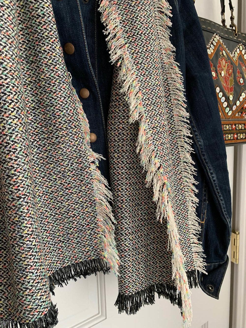 Finished fringe on fast no-sew upholstery fabric scarf draped over denim jacket