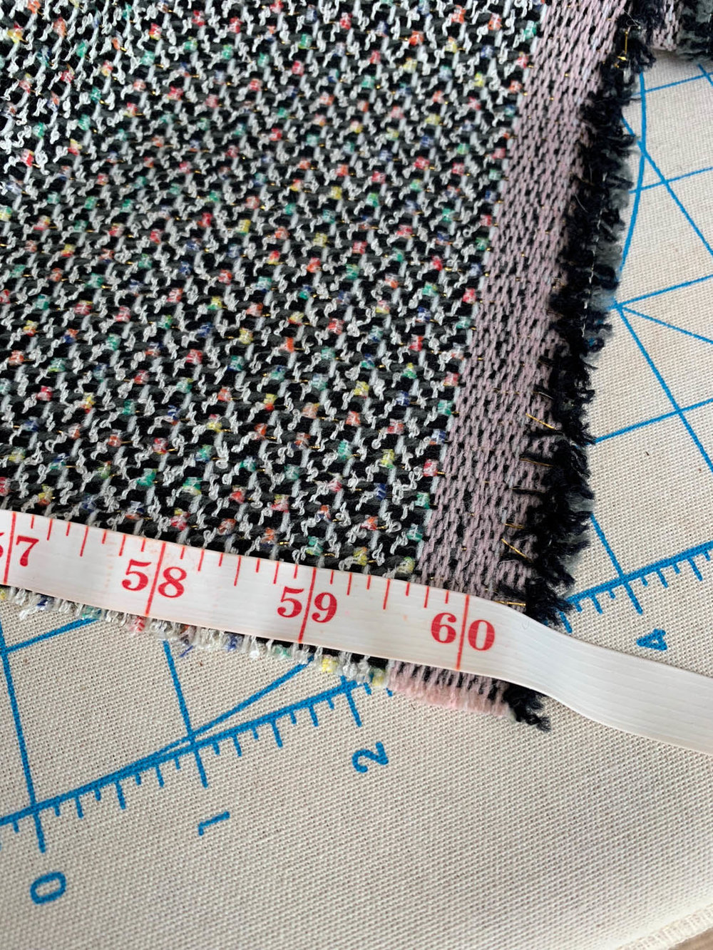 tape measure along edge of upholstery fabric
