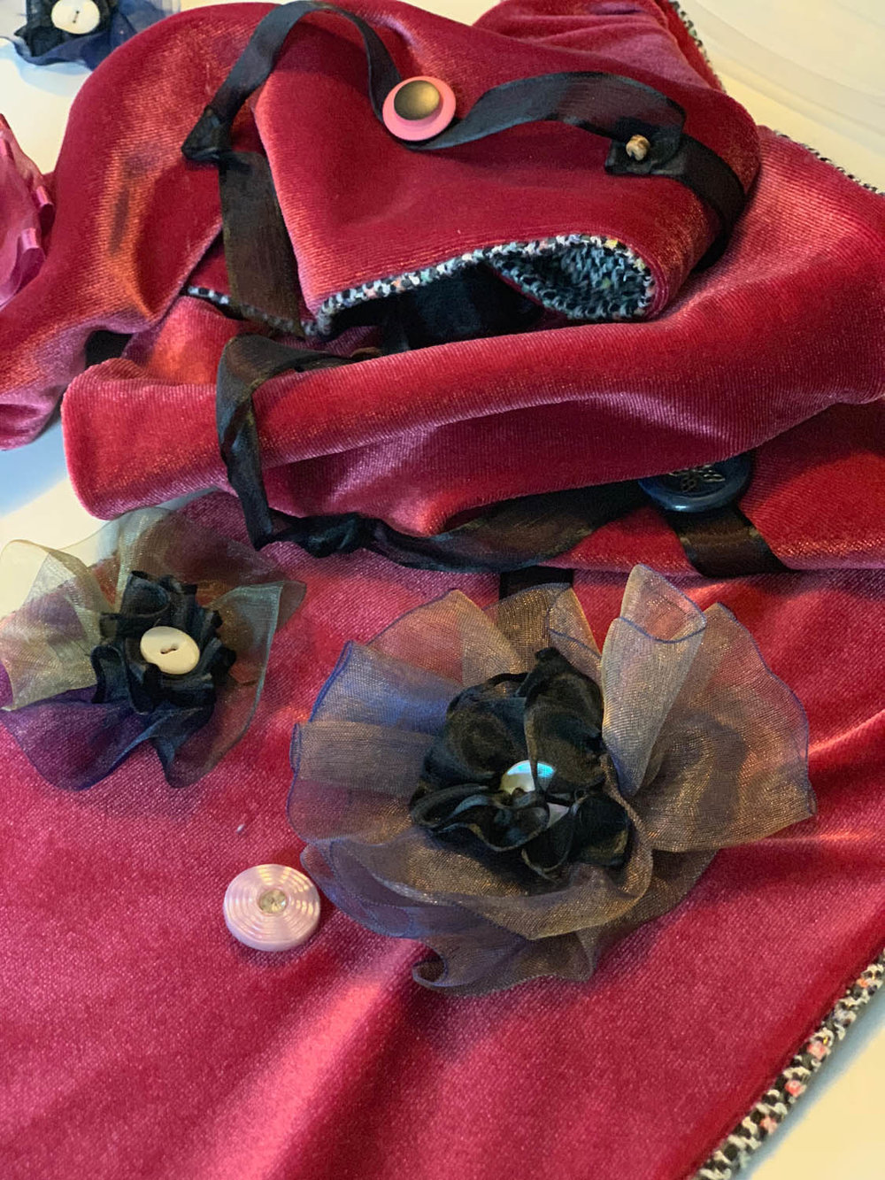 Silk ribbon flowers with button embellishments stitched to red velvet scarf