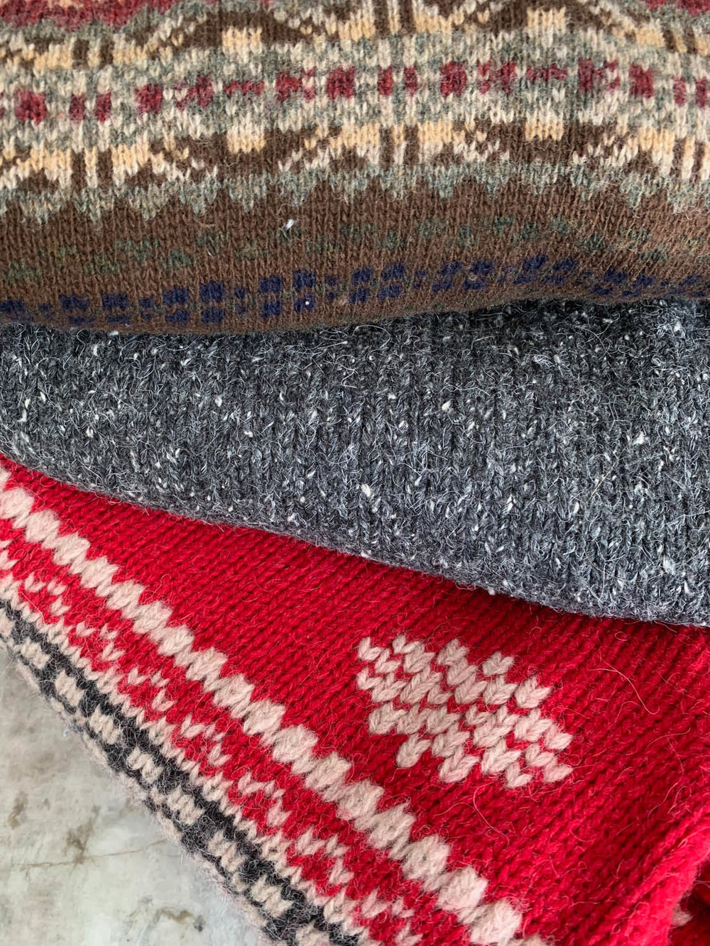 Three sweaters purchased from thrift store for upcycling