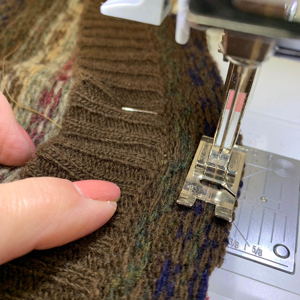 sewing upcycled sweater into stocking on sewing machine