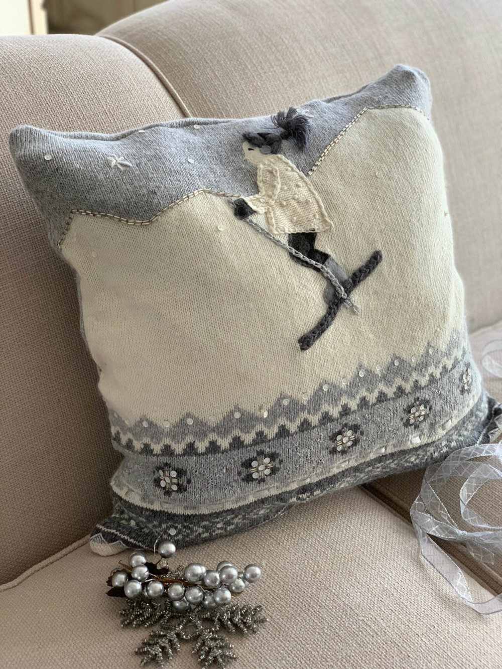 thrift store sweater pillow gray white with girl skiing