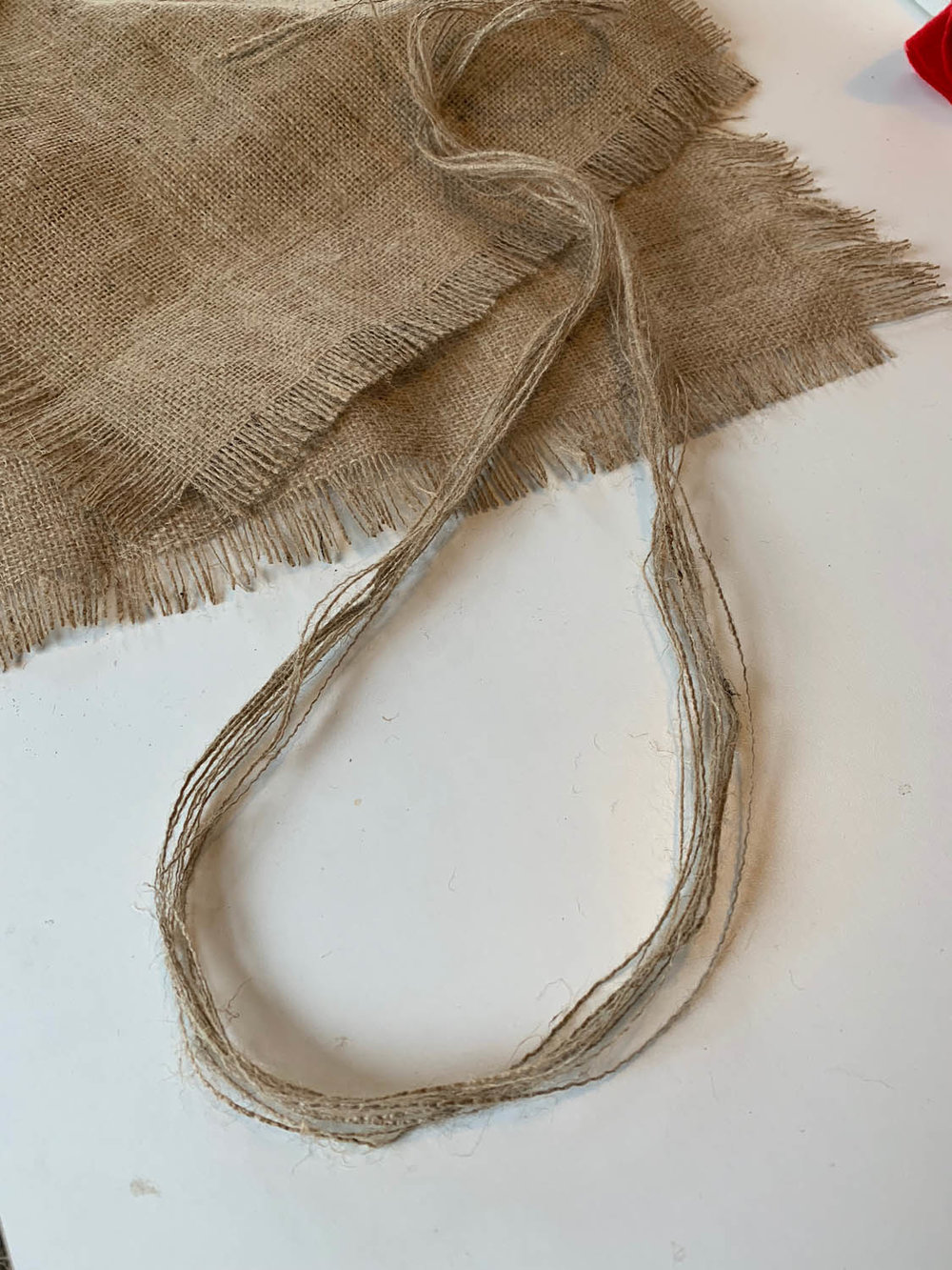 burlap scraps used as ribbon to embellish gifts