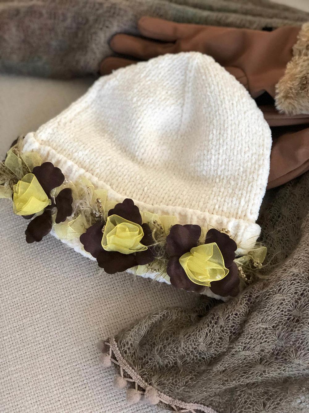 Elastic ribbon flower trim embellishing a purchased white chenille winter hat