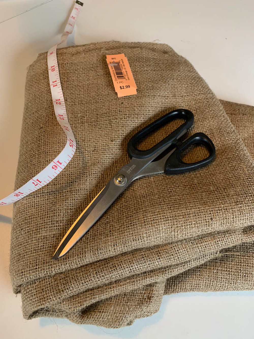 Burlap yardage with scissors and tape measure