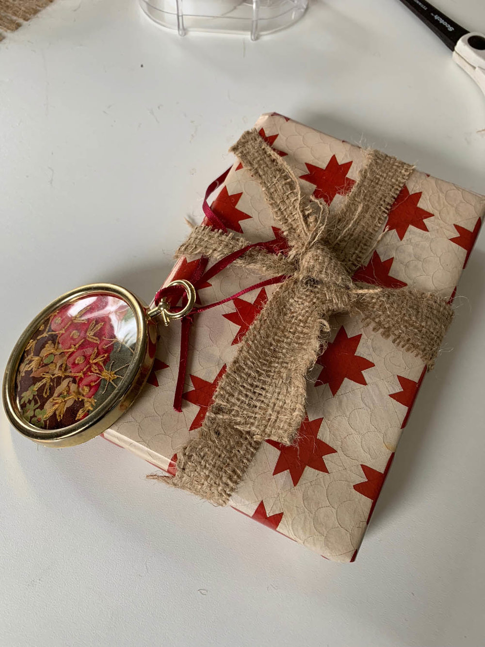 wrapped gift trimmed with burlap ribbon