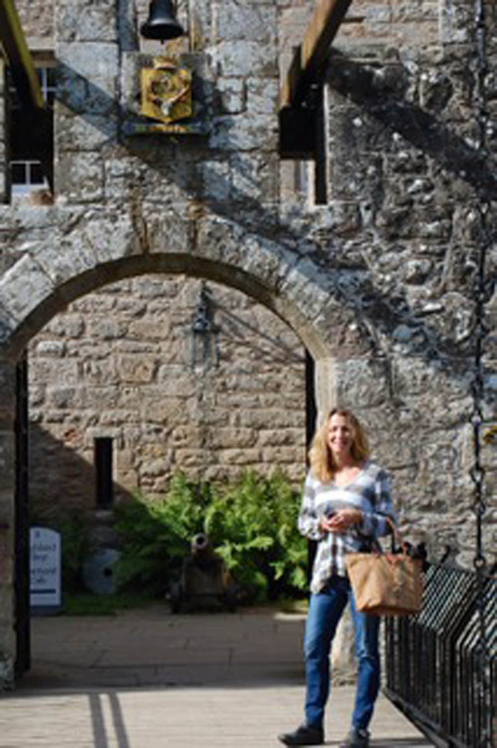 woman at entrance to Scottish Castle in Scotland