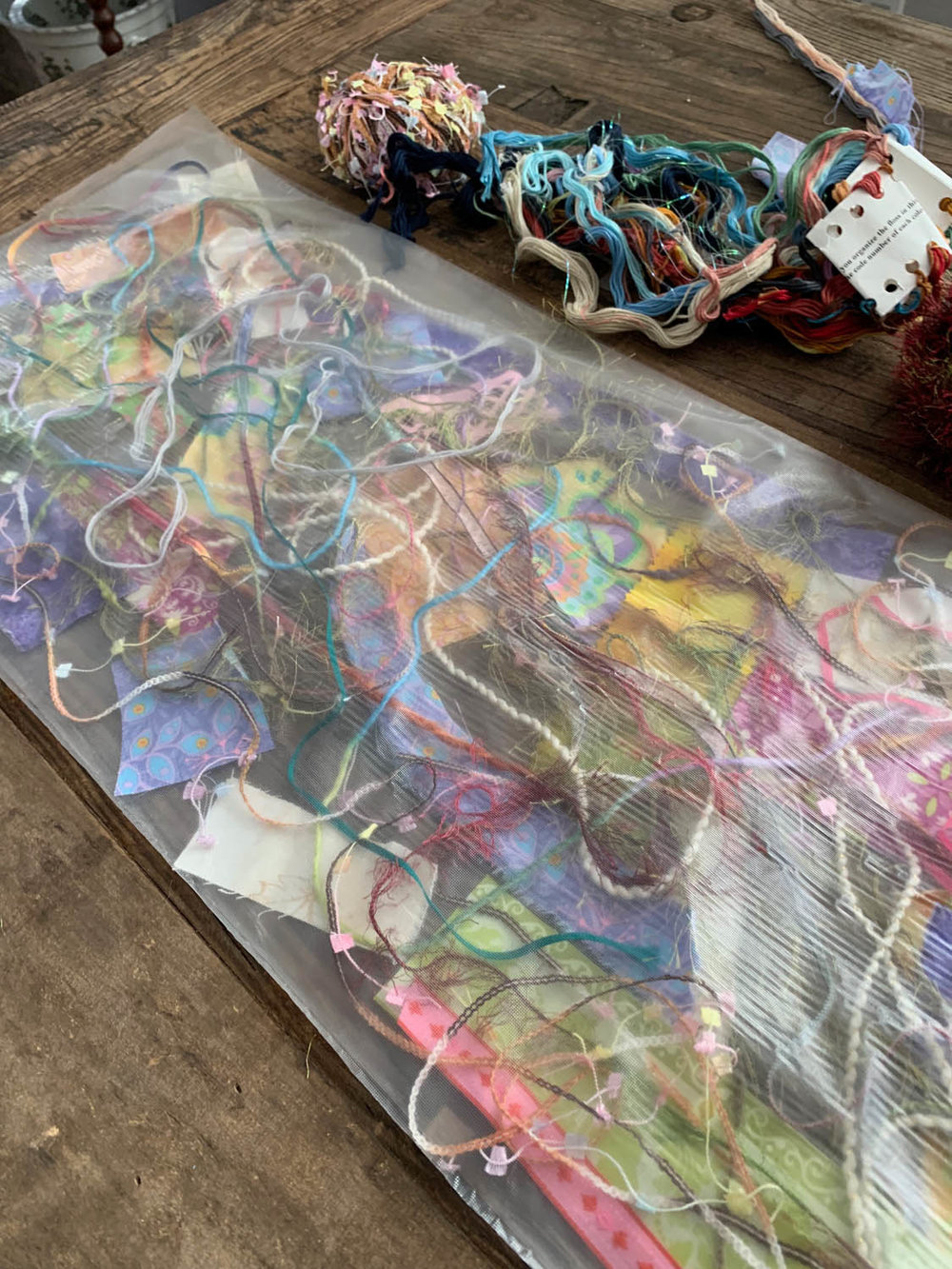 second layer of Sulky Solvy over top of fiber scraps before thread-quilting