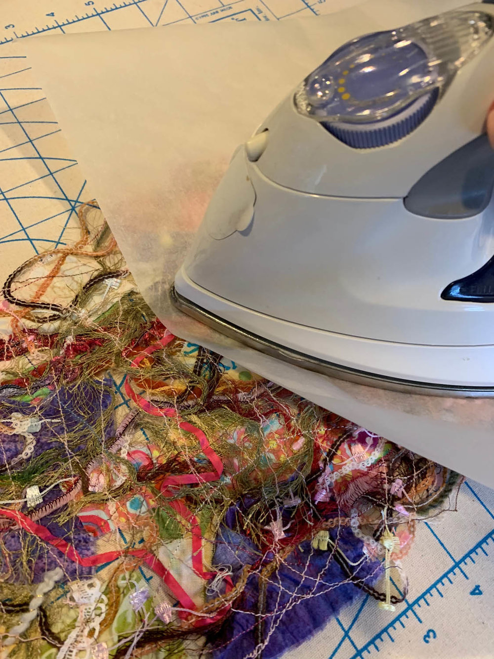 pressing and ironing thread-quilted upcycled fibers flat after rinsing and drying